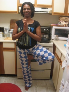 "Relaxing in the kitchen?  What is this?  (Alternative text might read ""Time for Tree Pose.  But not for fashion."")"