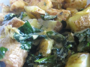 A tasty topping for home fries with mizuna greens and a side of crispy tofu bites...