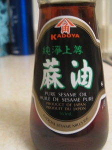 Toasted sesame oil, identifiable (even when just labeled 'sesame oil') by its dark brown hue.