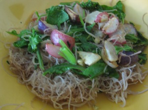 Crispy brown rice vermicelli with garlic, purple sage, and stir-fried radishes and radish tops.