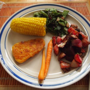 Chilliwack corn, mum-in-law's beans, our beet and turnip tops, our beet and turnip roots roasted with our garlic and onion from a friend.  Our carrots, and fishybits from local vegan company Gardein.
